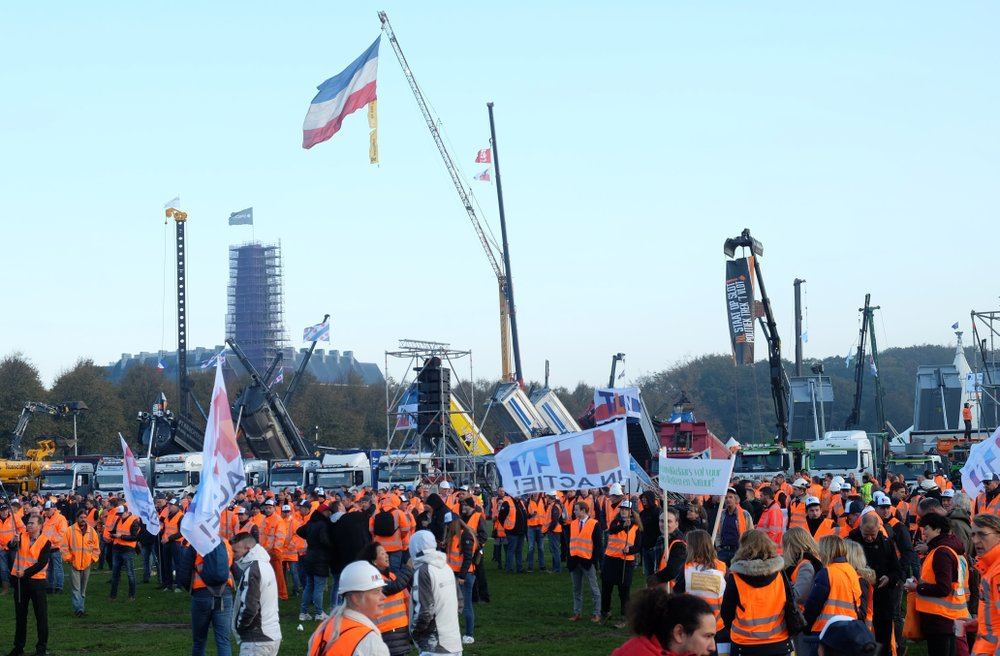 Dutch construction workers gather for a demonstration against the government's environmental rules, in The Hague, Netherlands on Wednesday, Oct. 30, 2019. The industry is protesting government limits on nitrogen emissions and rules about transporting sand and earth contaminated with tiny amounts of chemicals known as PFAS. (AP Photo/Mike Corder)
