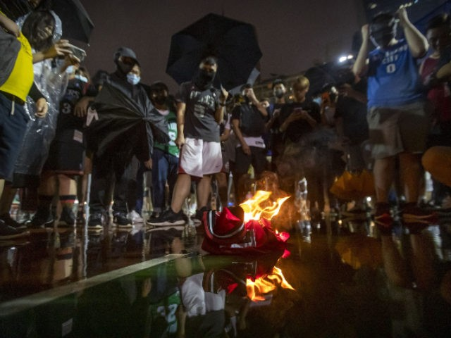 Hong Kong Demonstrators Trample and Burn LeBron James Jerseys
