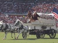 WATCH: Oklahoma's Sooner Schooner Wagon Crashes on Football Field