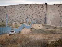 FILE - In this Jan. 4, 2016 file photo, a U.S. Border Patrol agent drives near the U.S.-Mexico border fence in Sunland Park, N.M. A new Cronkite News-Univision News-Dallas Morning News Border Poll released Monday, July 18, 2016, says a majority of residents surveyed on both sides of the U.S.-Mexico …