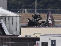 Wreckage is seen where World War II-era bomber plane crashed at Bradley International Airport in Windsor Locks, Conn., Wednesday, Oct. 2, 2019. A fire with black smoke rose from near the airport as emergency crews responded. The airport said in a message on Twitter that it has closed. (AP Photo/Jessica …