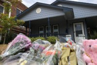Bouquets of flowers and stuffed animals are piling up outside the Fort Worth home Monday, Oct. 14, 2019, where a 28-year-old black woman was shot to death by a white police officer. Members of the community have brought tributes to the home where Atatiana Jefferson was killed early Saturday by …