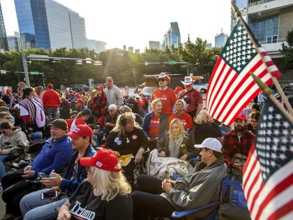 Supporters of President Donald Trump wait to enter a campaign rally as the sun rises, Thursday, Oct. 17, 2019, outside the American Airlines Center in Dallas. (AP Photo/Jeffrey McWhorter)