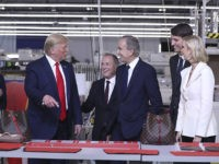 President Donald Trump tours the Louis Vuitton Workshop Rochambeau in Alvarado, Texas, Thursday, Oct. 17, 2019, with Bernard Arnault, chief executive of LVMH, third from right, Alexandre Arnault, second from right and Ivanka Trump. (AP Photo/Andrew Harnik)