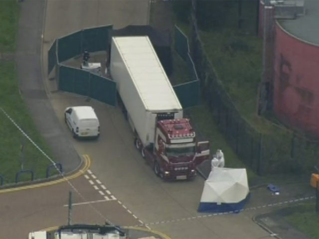 An aerial view as police forensic officers attend the scene after a truck was found to contain a large number of dead bodies, in Thurock, South England, early Wednesday Oct. 23, 2019. Police in southeastern England said that 39 people were found dead Wednesday inside a truck container believed to …