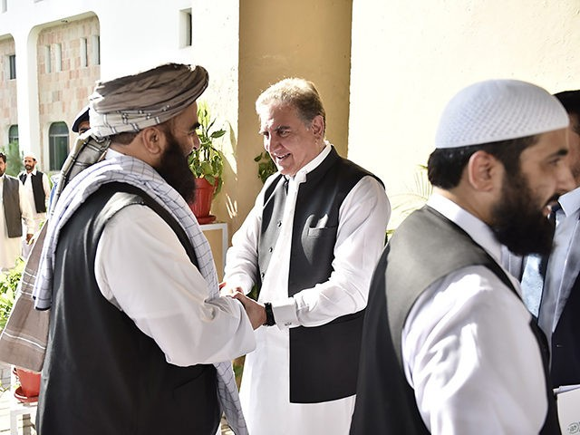 In this photo released by the Foreign Office, Pakistan's Foreign Minister Shah Mehmood Qureshi, center, receives members of Taliban delegation at the Foreign Office in Islamabad, Pakistan, Thursday, Oct. 3, 2019. Senior Taliban leaders are meeting with Qureshi in Islamabad as part of a push to revive an Afghanistan peace …