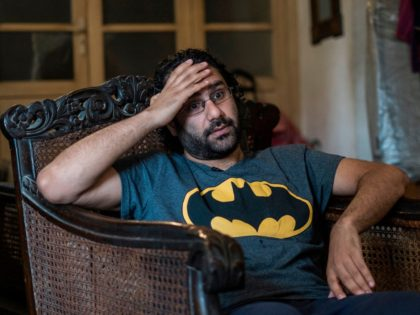 Egyptian activist and blogger Alaa Abdel Fattah gives an interview at his home in Cairo on May 17, 2019. - The days and nights of Alaa Abdel Fattah, Egypt's leading dissident, follow a disorienting rhythm where he is freed every morning from a filthy prison cell and then jailed again …