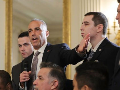 WASHINGTON, DC - FEBRUARY 21: (AFP OUT) Andrew Pollack (2nd L), whose daughter Meadow Pollack was shot to death last week at Marjory Stoneman Douglas High School, is joined by his sons as he addresses a listening session with U.S. President Donald Trump in the State Dining Room at the …