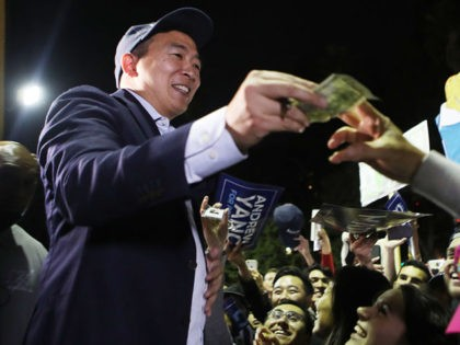 LOS ANGELES, CALIFORNIA - SEPTEMBER 30: Democratic presidential candidate, entrepreneur Andrew Yang (L) greets supporters and autographs items at a campaign rally on September 30, 2019 in Los Angeles, California. Yang is the son of Taiwanese immigrants and was born in upstate New York. (Photo by Mario Tama/Getty Images)