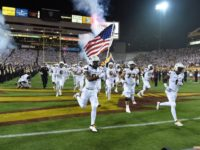 Arizona State football team holds flag