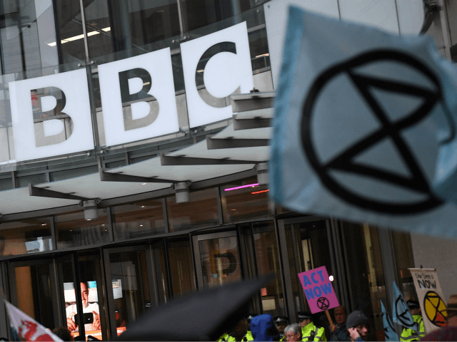 Climate activists protest at the BBC offices during the fifth day of demonstrations by the climate change action group Extinction Rebellion, in London, on October 11, 2019. - London police have reported making more than 1,000 arrests over four days of protests by the group Extinction Rebellion, which have been …