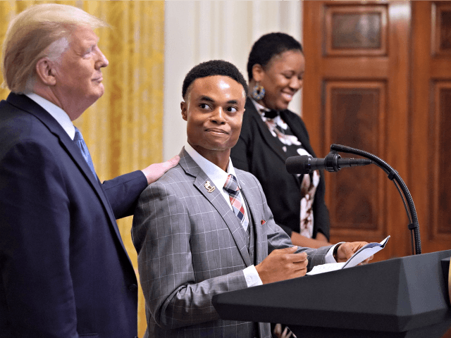 WASHINGTON, DC - OCTOBER 04: U.S. President Donald Trump invites U.S. Army veteran Ben Okereke, President of the Turning Points USA chapter at Georgia State University, to speak during an even for the Young Black Leadership Summit in the East Room of the White House October 04, 2019 in Washington, …