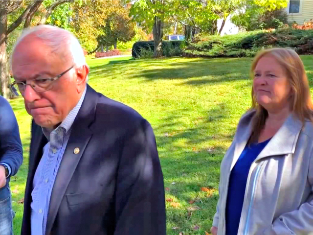 "In this image taken from video, Democratic presidential candidate Sen. Bernie Sanders, I-Vt., speaks we reporters outside his home, Tuesday, Oct. 8, 2019, in Burlington, Vt. His wife, Jane O'Meara Sanders listens at right. Sanders says he was ""dumb"" not to have listened to the symptoms he was experiencing before …"