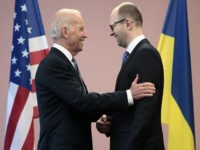 "U.S. Vice President Joe Biden, left, talks with Ukrainian Prime Minister Arseniy Yatsenyuk during a meeting in Kiev, Ukraine, Tuesday, April. 22, 2014. Biden called on Moscow to encourage pro-Russia separatists in eastern Ukraine to vacate government buildings and checkpoints, accept amnesty and ""address their grievances politically."" (AP Photo/Sergei Chuzavkov)"