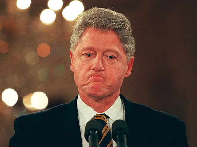 WASHINGTON, : US President Bill Clinton listens to a reporter's question 11 January during his first formal news conference of the the year in the East Room of the White House. Clinton spoke about his upcoming trip to Bosnia and also told reporters that he is optimistic that a balanced …