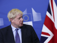 British Prime Minister Boris Johnson looks at European Commission President Jean-Claude Juncker as he reads a prepared statement during a press point at EU headquarters in Brussels, Thursday, Oct. 17, 2019. Britain and the European Union reached a new tentative Brexit deal on Thursday, hoping to finally escape the acrimony, …