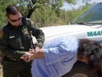 A Border Patrol agent places an illegal alien under arrest for smuggling. (Photo: U.S. Customs and Border Protection)