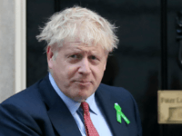 Britain's Prime Minister Boris Johnson reacts outside 10 Downing Street in central London on October 10, 2019, as he greets mental health campaigner Ben West (unseen), delivering a petition calling for compulsory mental health first aid training for teachers. (Photo by ISABEL INFANTES / AFP) (Photo by ISABEL INFANTES/AFP via …
