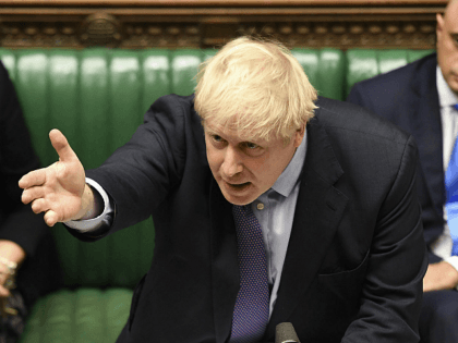 Britain's Prime Minister Boris Johnson gestures as he speaks in the House of Commons in London during the debate for the EU Withdrawal Agreement Bill, Tuesday Oct. 22, 2019. British lawmakers have rejected the government's fast-track attempt to pass its Brexit bill within days, demanding more time to scrutinize the …