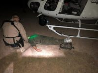 A U.S. Border Patrol agent working with a CBP Air and Marine Operations aircrew provides emergency medical care for a Honduran woman who collapsed in the desert. (Photo: U.S. Customs and Border Protection/Air and Marine Operations)