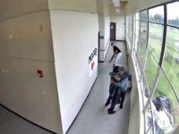 Coach Takes Gun, Hugs Student