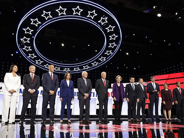 From left, Democratic presidential candidates, Rep. Tulsi Gabbard, D-Hawaii, businessman Tom Steyer, Sen. Cory Booker, D-N.J., Sen. Kamala Harris, D-Calif., Sen. Bernie Sanders, I-Vt., former Vice President Joe Biden, Sen. Elizabeth Warren, D-Mass., South Bend Mayor Pete Buttigieg, entrepreneur Andrew Yang, former Texas Rep. Beto O'Rourke, Sen. Amy Klobuchar, D-Minn., …