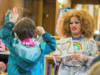 In this Saturday, May 13, 2017 photo, Lil Miss Hot Mess reads to children during the Feminist Press' presentation of Drag Queen Story Hour! at the Park Slope Branch of the Brooklyn Public Library, in New York. (AP Photo/Mary Altaffer)