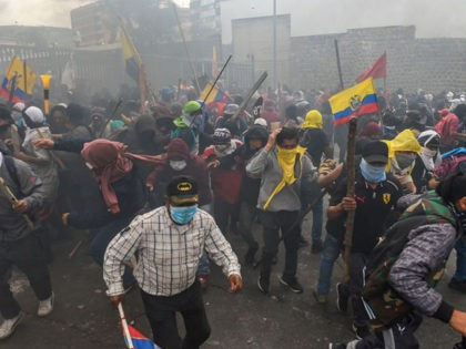 Demonstrators clash with riot police near the national assembly in Quito on October 8, 2019 following days of protests against the sharp rise in fuel prices sparked by authorities' decision to scrap subsidies. - Thousands of demonstrators converged on the Ecuadoran capital Quito on Tuesday as intensifying protests against soaring …