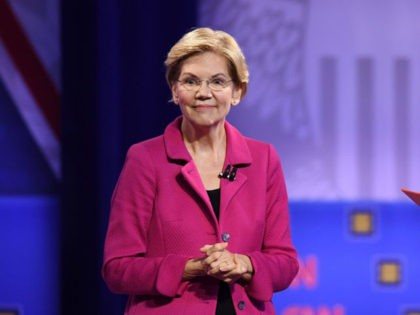 Democratic presidential hopeful Massachusetts Senator Elizabeth Warren (L) gestures as she speaks alongside CNN moderator Chris Cuomo during a town hall devoted to LGBTQ issues hosted by CNN and the Human rights Campaign Foundation at The Novo in Los Angeles on October 10, 2019. (Photo by Robyn Beck / AFP) …