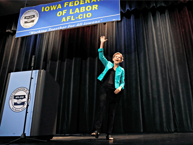 Democratic presidential candidate Sen. Elizabeth Warren waves to audience members after speaking at the Iowa Federation of Labor convention, Wednesday, Aug. 21, 2019, in Altoona, Iowa. (AP Photo/Charlie Neibergall)