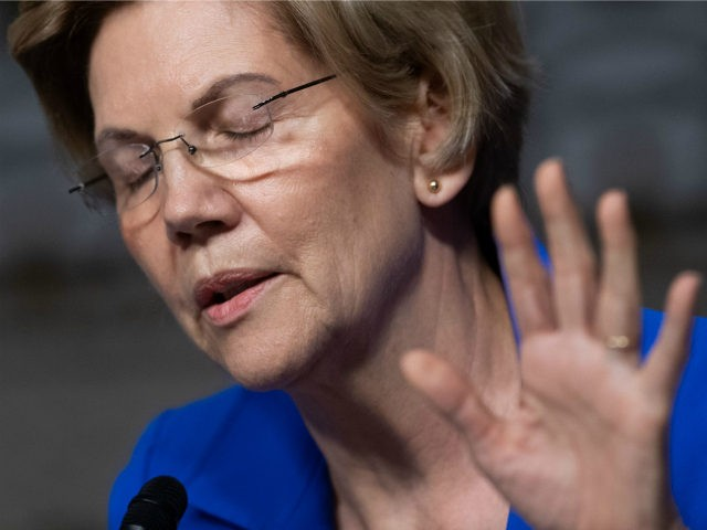 US Senator Elizabeth Warren, Democrat of Massachusetts, questions US Secretary of the Army Mark Esper, nominee to be Secretary of Defense, during a Senate Armed Services Committee confirmation hearing on Capitol Hill in Washington, DC, July 16, 2019. (Photo by SAUL LOEB / AFP) (Photo credit should read SAUL LOEB/AFP/Getty …