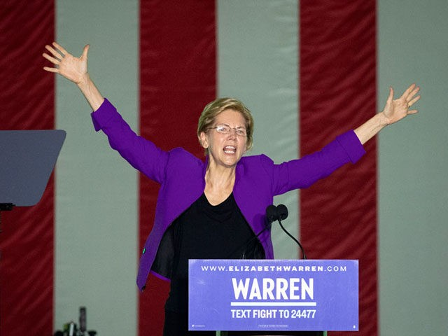 NEW YORK, NY - SEPTEMBER 16: 2020 Democratic presidential candidate Sen. Elizabeth Warren (D-MA) waves to the crowd at the end of a rally in Washington Square Park on September 16, 2019 in New York City. Warren unveiled a sweeping anti-corruption plan earlier on Monday. (Photo by Drew Angerer/Getty Images)