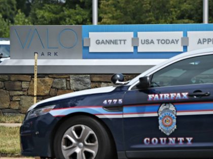 Police and first responders gather at the Gannett headquarters, home of USA Today, in McLean, Virginia, on August 7, 2019. - The newspaper USA Today evacuated its headquarters in northern Virginia on Wednesday following an alleged sighting of an armed man at the building, but later said the report was …