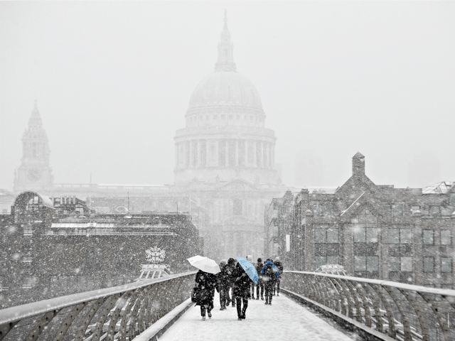 LONDON, UNITED KINGDOM - MARCH 02: Saint Paul's Cathedral is just visible through a blizzard as people cross the River Thames on March 2, 2018 in London, United Kingdom. Weather fronts dubbed Storm Emma and The Beast From The East have combined to create freezing conditions that have bought much …