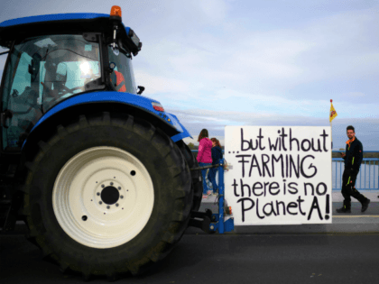 "A tractor with a sign reading ""...but without farming there is no planet A"" stands on the Kennedy bridge as farmers protest against the German government's agricultural policy including plans to phase out glyphosate pesticides and to implement more animal protection, during a demonstration in Bonn, western Germany on October …"