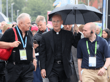 "US Jesuit priest James Martin (C) arrives at the World Meeting of Families in Dublin on August 23, 2018. - Gay people in the Catholic Church are sometimes ""treated like dirt"", according to a priest invited by the Vatican to address a conference on families today ahead of a visit …"