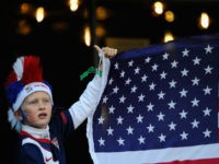 PRETORIA, SOUTH AFRICA - JUNE 23: A young USA fan with his national flag as he enjoys the atmosphere ahead of the 2010 FIFA World Cup South Africa Group C match between USA and Algeria at the Loftus Versfeld Stadium on June 23, 2010 in Tshwane/Pretoria, South Africa. (Photo by …
