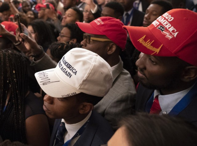 WASHINGTON, DC - OCTOBER 26: (AFP OUT) Attendees listen as U.S. President Donald Trump addresses young black conservative leaders from across the country as part of the 2018 Young Black Leadership Summit in the East Room of the White House on October 26, 2018 in Washington, DC. (Photo by Chris …