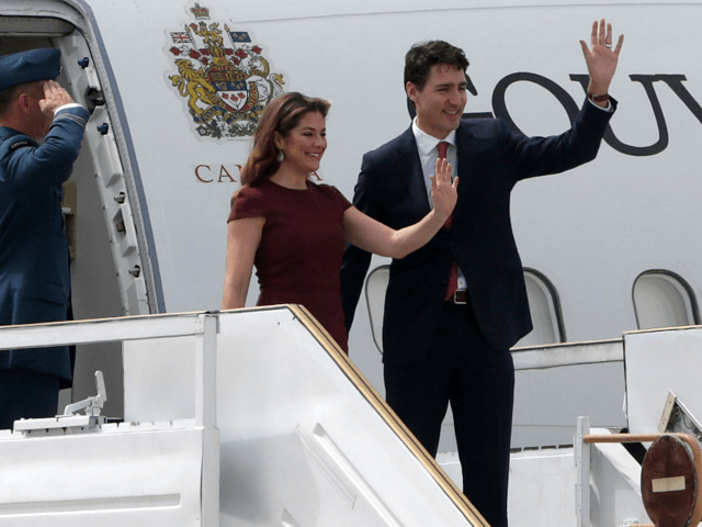 BUENOS AIRES, ARGENTINA - NOVEMBER 29: Canadian Prime Minister Justin Trudeau and First Lady of Canada Sophie Gregoire Trudeau wave as they get off a plane on their arrival to Buenos Aires for G20 Leaders' Summit 2018 at Ministro Pistarini International Airport on November 29, 2018 in Ezeiza, Buenos Aires, …