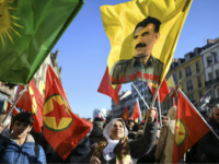"A woman holds a flag with the portrait of Kurdish leader Abdullah Ocalan during a demonstration in Strasbourg, eastern France, on February 16, 2019, to mark 20 years since the arrest of Ocalan, who is jailed in Turkey. - Labelled the ""nemesis"" of the Turkish state, Ocalan remains a revered …"