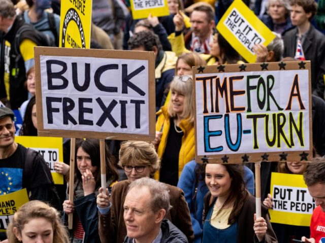 People hold up placards as they attend a march and rally organised by the pro-European People's Vote campaign for a second referendum in central London on March 23, 2019. - Hundreds of thousands of pro-Europeans from across Britain were expected to march through London on Saturday calling for another referendum …