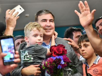 Former Georgian leader Mikheil Saakashvili (C) is greeted by his supporters after his arriving in Kiev's Boryspil airport on May 29, 2019. - Ukraine's new President Volodymyr Zelensky on May 28, 2019 restored the Ukrainian citizenship of Saakashvili, less than two years after he was stripped of it and expelled. …