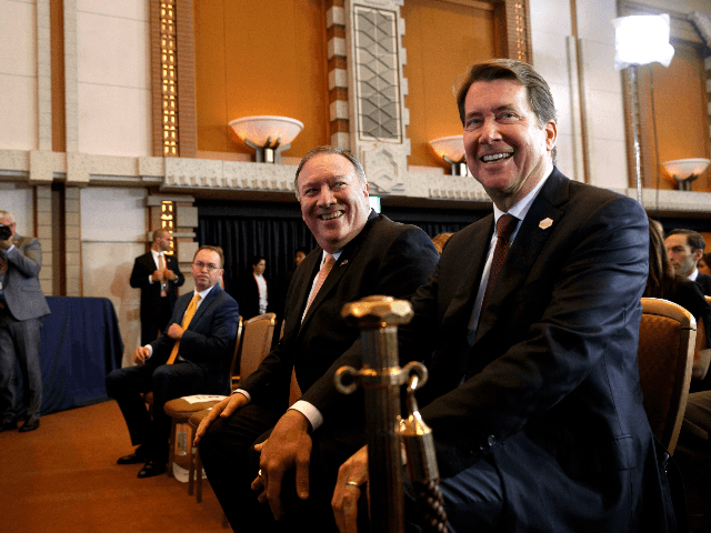 US Secretary of State Mike Pompeo (C) sits between US Ambassador to Japan William Hagerty (R) and Acting Chief of Staff Mick Mulvaney as they arrive for a news conference by US President Donald Trump in Osaka on June 29, 2019. (Photo by Jacquelyn Martin / POOL / AFP) (Photo …