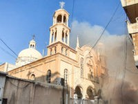 People gather at the scene of a car bomb explosion outside the Syriac Orthodox Church of the Virgin Mary in the predominantly Christian neighbourhood of al-Wasti in the Kurdish-majority city of Qamishli in northeast Syria on July 11, 2019. - There was no immediate claim for the attack, which Syrian …