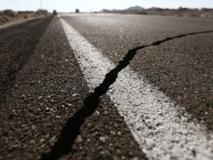 A crack stretches across the road after a 6.4 magnitude earthquake struck the area on July 4, 2019 near Ridgecrest, California. The earthquake was the largest to strike Southern California in 20 years with the epicenter located in a remote area of the Mojave Desert. The temblor was felt by …