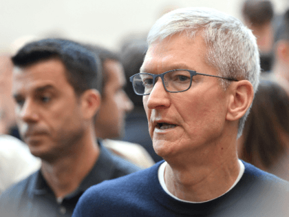 Apple CEO Tim Cook speaks with attendees during an Apple product launch event at Apple's headquarters in Cupertino, California on September 10, 2019. - Apple unveiled its iPhone 11 models Tuesday, touting upgraded, ultra-wide cameras as it updated its popular smartphone lineup and cut its entry price to $699. (Photo …