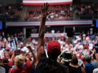 MANCHESTER, NEW HAMPSHIRE - AUGUST 15: People cheer as President Donald Trump speaks to supporters at a rally in Manchester on August 15, 2019 in Manchester, New Hampshire. The Trump 2020 campaign is looking to flip the battleground state of New Hampshire with the use of a strong economy and …