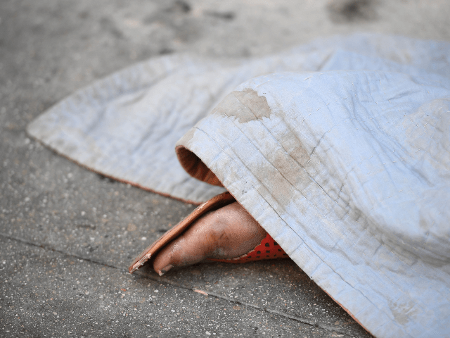 A homeless person sleeps on the street on Skid Row in Los Angeles, California on September 17, 2019. - US President Donald Trump has indicated he plans to address the homeless crisis in California as he lands later today in Los Angeles for a two-day visit with stops for fundraising …