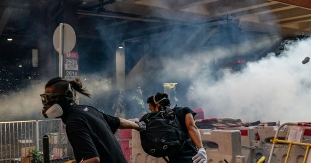 Hong Kong Police Fire Tear Gas at People Protesting Tear Gas