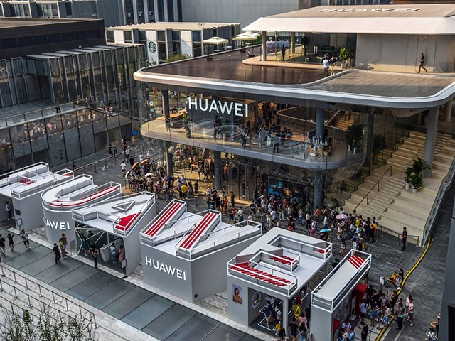 This aerial photo taken on September 28, 2019 shows people visiting a newly-opened Huawei flagship store in Shenzhen in China's southern Guangdong province. (Photo by STR / AFP) / China OUT (Photo credit should read STR/AFP/Getty Images)